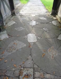 Millstones under the Wing lychgate, September 2013